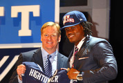 Dont'a Hightower of Alabama holds up a jersey as he stands on stage with NFL Commissioner Roger Goodell after he was selected #25 overall by the New England Patriots in the first round of the 2012 NFL Draft at Radio City Music Hall on April 26, 2012 in New York City.