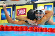 (L-R) Rebecca Soni and Jessica Hardy celebrate after they competedin the second semifinal heat of the Women's 100 m Breaststroke during Day Two of the 2012 U.S. Olympic Swimming Team Trials at CenturyLink Center on June 26, 2012 in Omaha, Nebraska.
