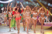 (L-R) Victoria's Secret Angels Adriana Lima, Doutzen Kroes, Candice Swanepoel, and Erin Heatherton walk the runway during the 2012 Victoria's Secret Fashion Show at the Lexington Avenue Armory on November 7, 2012 in New York City.