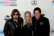 (L-R) Singer Billy Ray Cyrus, Kathleen McCrone and singer Wayne Newton attend the 2013 American Music Awards at Nokia Theatre L.A. Live on November 24, 2013 in Los Angeles, California.
