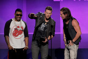 (L-R) Rapper Nelly with singers Brian Kelley and Tyler Hubbard of Florida Georgia Line accept the Single of the Year award for 'Cruise' onstage during the 2013 American Music Awards at Nokia Theatre L.A. Live on November 24, 2013 in Los Angeles, California.