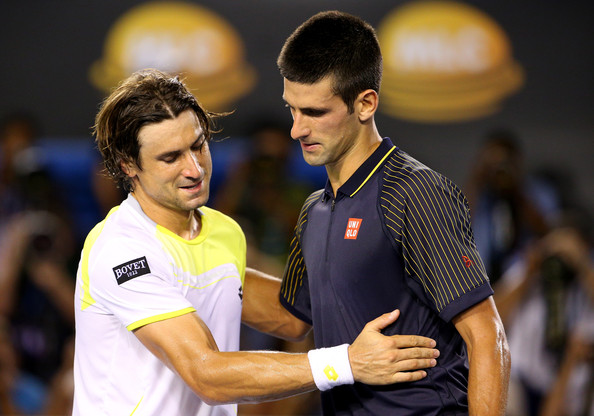 Novak Djokovic of Serbia shakes hands with David Ferrer of Spain after Djokovic won their Semifinal match against during day eleven of the 2013 Australian Open at Melbourne Park on January 24, 2013 in Melbourne, Australia.