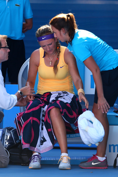Victoria Azarenka of Belarus receives medical attention in her Semifinal match against Sloane Stephens of the United States during day eleven of the 2013 Australian Open at Melbourne Park on January 24, 2013 in Melbourne, Australia.