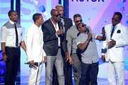 (L-R) Actors Duane Martin, Nick Cannon, JB Smoove, Boris Kodjoe, recording artist Nelly, comedian Kevin Hart, and recording artist Bobby Brown present an award onstage during the 2013 BET Awards at Nokia Theatre L.A. Live on June 30, 2013 in Los Angeles, California.