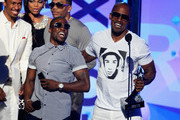 (L-R) Actors Nick Cannon, Kevin Hart, Nelly, and Jamie Foxx speak onstage during the 2013 BET Awards at Nokia Theatre L.A. Live on June 30, 2013 in Los Angeles, California.