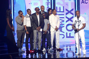 (L-R) Actors Duane Martin, Nick Cannon, JB Smoove, Boris Kodjoe, recording artist Nelly, comedian Kevin Hart, and recording artist Bobby Brown present an award to actor Jamie Foxx onstage during the 2013 BET Awards at Nokia Theatre L.A. Live on June 30, 2013 in Los Angeles, California.