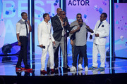 (L-R) Actors Duane Martin, Nick Cannon, JB Smoove, Boris Kodjoe, recording artist Nelly, comedian Kevin Hart, and recording artist Bobby Brown present onstage during the 2013 BET Awards at Nokia Theatre L.A. Live on June 30, 2013 in Los Angeles, California.