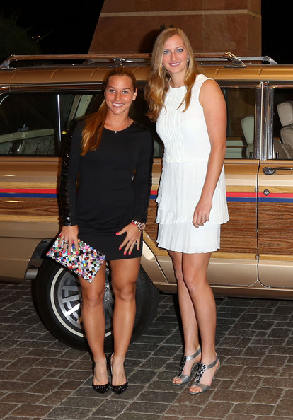 Dominica Cibulkova of Slovakia and Petra Kvitova of the Czech Republic arrive for a player's party at the IW Club on March 7, 2013 in Indian Wells, California.