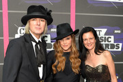 (L-R) Michael Lockwood, Lisa Marie Presley, and Leslie Fram, SVP of Music Strategy CMT, attend the 2013 CMT Music awards at the Bridgestone Arena on June 5, 2013 in Nashville, Tennessee.