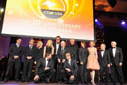 (L-R) Past honorees Anthony Lapaglia, Mel Gibson, Olivia Newton-John, Hugh Jackman, Toni Collette, Luc Longley, Russell Hitchcock, Simon Baker,Graham Russell, Keith Urban, Nicole Kidman, Rod Laver and Roy Emerson onstage during the 2013 G'Day USA Los Angeles Black Tie Gala at JW Marriott Los Angeles at L.A. LIVE on January 12, 2013 in Los Angeles, California.