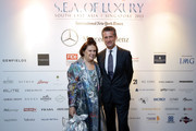 Stephen Dunbar-Johnson, President, International, International New York Times and International Fashion Editor, Suzy Menkes arrive at the International New York Times Luxury gala on November 21, 2013 in Singapore. The 13th annual International New York Times Luxury conference is the premier meeting point for the luxury industry 500 delegates from 30 countries have gathered in Singapore to hear from the world's most inspirational fashion designers and luxury business leaders.