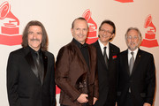 (L-R) Chairman of the Latin Recording Academy Luis Cobos, honoree Miguel Bose, Recording Academy President/CEO Neil Portnow and President and CEO of the Latin Recording Academy Gabriel Abaroa arrive at the 2013 Latin Recording Academy Person Of The Year honoring Miguel Bose at the Mandalay Bay Events Center on November 20, 2013 in Las Vegas, Nevada.