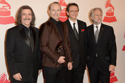 (L-R) Chairman of the Latin Recording Academy Luis Cobos, Honoree Miguel Bose, President and CEO of the Latin Recording Academy Gabriel Abaroa and President of National Academy of Recording Arts and Sciences Neil Portnow arrive at the 2013 Latin Recording Academy Person Of The Year honoring Miguel Bose at the Mandalay Bay Events Center on November 20, 2013 in Las Vegas, Nevada.