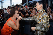 Katy Perry (R) and Richard Simmons attend the 2013 MTV Video Music Awards at the Barclays Center on August 25, 2013 in the Brooklyn borough of New York City.