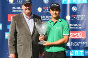 Jin Jeong of Korea poses with the winners trophy with John McGrath MLA during day four of the Perth International at Lake Karrinyup Country Club on October 20, 2013 in Perth, Australia.