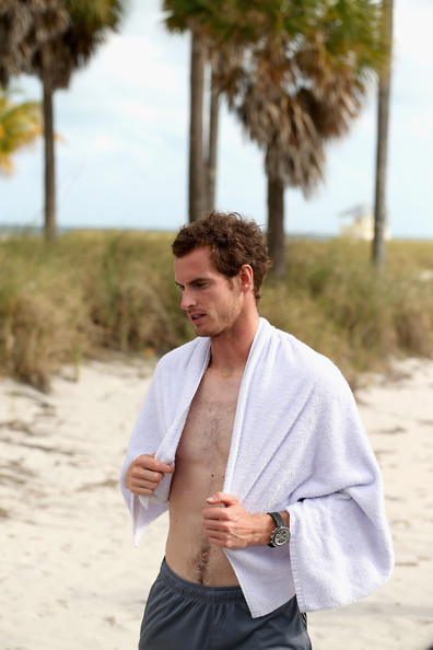 Andy Murray of Great Britain dries off with a towell after a swim in the ocean after his three set victory against David Ferrer of Spain during their final match at the Sony Open at Crandon Park Tennis Center on March 31, 2013 in Key Biscayne, Florida.