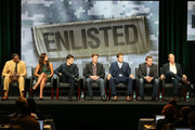 """(L-R) Actors Keith David, Angelique Cabral, Parker Young, Chris Lowell, Geoff Stults, Co-Creators/Executive Producers Kevin Biegel, and Mike Royce speak onstage during the """"Enlisted"""" panel discussion at the FOX portion of the 2013 Summer Television Critics Association tour - Day 9 at The Beverly Hilton Hotel  on August 1, 2013 in Beverly Hills, California."""