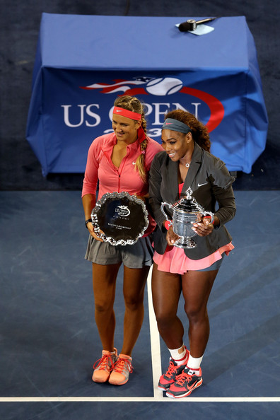 Serena Williams of the United States of America smiles as she poses with the trophy next to Victoria Azarenka of Belarus after winning the women's singles final match on Day Fourteen of the 2013 US Open at the USTA Billie Jean King National Tennis Center on September 8, 2013 in the Flushing neighborhood of the Queens borough of New York City.