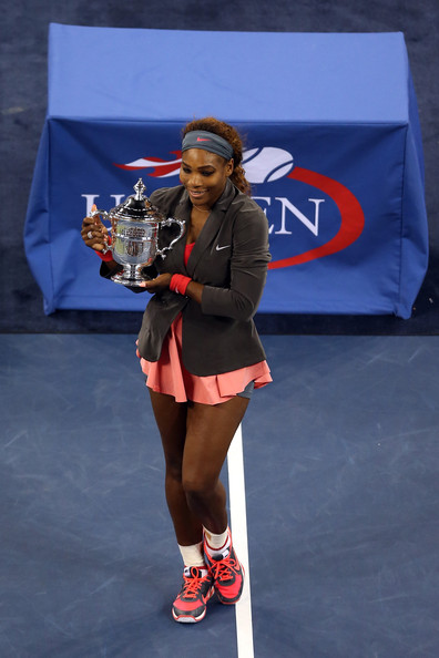 Serena Williams of the United States of America smiles as she poses with the trophy after winning her women's singles final match against Victoria Azarenka of Belarus on Day Fourteen of the 2013 US Open at the USTA Billie Jean King National Tennis Center on September 8, 2013 in the Flushing neighborhood of the Queens borough of New York City.