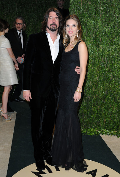 Musician Dave Grohl (L) and Jordyn Blum arrive at the 2013 Vanity Fair Oscar Party hosted by Graydon Carter at Sunset Tower on February 24, 2013 in West Hollywood, California.