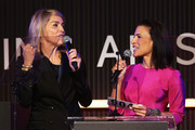 Actress Sharon Stone and President, Christie's Los Angeles Andrea Fiuczynski speak onstage during the 2013 amfAR Inspiration Gala Los Angeles presented by MAC Viva Glam at Milk Studios on December 12, 2013 in Los Angeles, California.