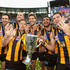 Sam Mitchell Jarryd Roughead Photos - Jordan Lewis, Jarryd Roughead, Sam Mitchell, Grant Birchall, Cyril Rioli and Luke Hodge of the Hawks celebrate with the Premeirship Cup during the 2014 AFL Grand Final match between the Sydney Swans and the Hawthorn Hawks at Melbourne Cricket Ground on September 27, 2014 in Melbourne, Australia. - 2014 AFL Grand Final - Sydney v Hawthorn