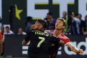 Sean Franklin #7 of the MLS All-Stars battles for a ball with Thomas Muller #25 of Bayern Munich during the second half of the game at Providence Park on August 6, 2014 in Portland, Oregon.
