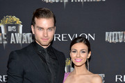 Actor Pierson Fode (L) and actress/recording artist Victoria Justice attend the after party for the 2014 MTV Movie Awards at Nokia Theatre L.A. Live on April 13, 2014 in Los Angeles, California.