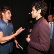 He hangs out backstage with Adrian Grenier.