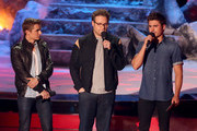 (L-R) Actors Dave Franco, Seth Rogen and Zac Efron speak onstage at the 2014 MTV Movie Awards at Nokia Theatre L.A. Live on April 13, 2014 in Los Angeles, California.