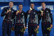(L-R) Matt Mclean, Ryan Lochte, Michael Phelps and Coner Dwyer of the United States celebrate winning the Men's 4 x 200m Freestyle Relay Final during day two of the 2014 Pan Pacific Championships at Gold Coast Aquatics on August 22, 2014 on the Gold Coast, Australia.