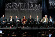 "(L-R) Actors Cory Michael Smith, Camren Bicondova, Robin Lord Taylor, Jada Pinkett Smith, Donal Logue, and Benjamin McKenzie, and producers Bruno Heller and Danny Cannon speak onstage at the ""Gotham"" panel during the FOX Network portion of the 2014 Summer Television Critics Association at The Beverly Hilton Hotel on July 20, 2014 in Beverly Hills, California."