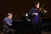 Tim Fain and Philip Glass perform during the 2014 Tibet Benefit concert at Carnegie Hall on March 11, 2014 in New York City.