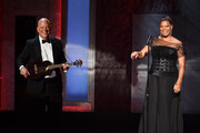 Musician Tim May (L) and actress/singer Queen Latifah perform onstage during the 2015 AFI Life Achievement Award Gala Tribute Honoring Steve Martin at the Dolby Theatre on June 4, 2015 in Hollywood, California. 25292_003