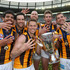 Luke Hodge Jarryd Roughead Photos - Cyril Rioli, Jordan Lewis, Sam Mitchell, Jarryd Roughead, Grant Birchall and Luke Hodge of the Hawks celebrate with the trophy after winning the 2015 AFL Grand Final match between the Hawthorn Hawks and the West Coast Eagles at Melbourne Cricket Ground on October 3, 2015 in Melbourne, Australia. - 2015 AFL Grand Final - Hawthorn v West Coast