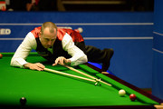 Mark Williams of Wales plays a shot against  Matthew Stevens of Wales during day five of the 2015 Betfred World Snooker Championship at Crucible Theatre on April 22, 2015 in Sheffield, England.