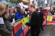 """Musician Peter Wentz (L) and actor/recording artist Ludacris (R) sign autographs at the """"2015 Billboard Music Awards"""" Finalists Live Announcement on """"Good Morning America"""" at ABC News' Good Morning America Times Square Studio on April 7, 2015 in New York City."""