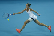 Bojana Jovanovski of Serbia in action against  Caroline Wozniacki of Denmark during the women's singles first round match on day two of the 2015 China Open at the China National Tennis Centre on October 4, 2015 in Beijing, China.