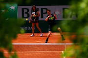 Andy Murray of Great Britain is watched by his coach Amelie Mauresmo as he plays a forehand during a practice session on day six of the 2015 French Open at Roland Garros on May 29, 2015 in Paris, France.