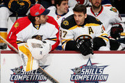 Roberto Luongo #1 of the Florida Panthers and Team Toews talks with Patrice Bergeron #37 of the Boston Bruins and Team Toews during the Honda NHL Breakaway Challenge event of the 2015 Honda NHL All-Star Skills Competition at Nationwide Arena on January 24, 2015 in Columbus, Ohio.