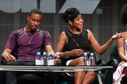 (L-R) Actors Jessie T. Usher and Tichina Arnold speak onstage during the 'Survivor's Remorse' panel discussion at the STARZ portion of the 2015 Summer TCA Tour at The Beverly Hilton Hotel on July 31, 2015 in Beverly Hills, California.