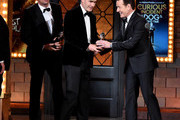"""Bryan Cranston presents Michael Morris with the award for Best Play for """"The Curious Incident of the Dog in the Night-Time"""" onstage during the 2015 Tony Awards at Radio City Music Hall on June 7, 2015 in New York City."""