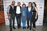 "Musicans Kinan Azmeh, Kayhan Kalhor, Wu Man, Yo-Yo Ma and Cristina Pato attend ""The Music of Strangers: Yo-Yo Ma and the Silk Road Ensemble"" photo call during the 2015 Toronto International Film Festival at The Elgin on September 13, 2015 in Toronto, Canada."