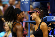 (L-R) Serena Williams of the United States talks with Vitalia Diatchenko of Russian after their Women's Singles First Round match on Day One of the 2015 US Open at the USTA Billie Jean King National Tennis Center on August 31, 2015 in the Flushing neighborhood of the Queens borough of New York City.