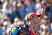 Sabine Lisicki of Germany waves to the crowd after being defeated by Simona Halep of Romania during their Women's Singles Fourth Round match on Day Eight of the 2015 US Open at the USTA Billie Jean King National Tennis Center on September 7, 2015 in the Flushing neighborhood of the Queens borough of New York City.