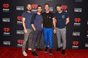 (L-R) Musicians Will Champion, Guy Berryman, Chris Martin and Jonny Buckland of Coldplay attend the 2015 iHeartRadio Music Festival at MGM Grand Garden Arena on September 18, 2015 in Las Vegas, Nevada.