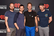 Musicians Will Champion, Guy Berryman, Chris Martin and Jonny Buckland of Coldplay attend the 2015 iHeartRadio Music Festival at MGM Grand Garden Arena on September 18, 2015 in Las Vegas, Nevada.