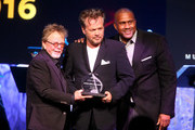 (L-R) ASCAP President and Chairman Paul Williams, honoree John Mellencamp (recipient of the ASCAP Founders Award) and TV personality Tavis Smiley pose onstage during the 2016 ASCAP Pop Awards at the Dolby Ballroom on April 27, 2016 in Hollywood, California.