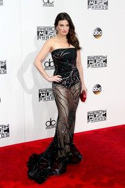 Idina Menzel flashed some leg in a sheer, fireworks-motif strapless gown at the 2016 AMAs.