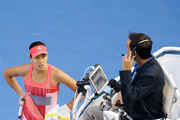 Ana Ivanovic of Serbia speaks with the umpire after her coach collapsed in the stands during her third round match against Madison Keys of America during day six of the 2016 Australian Open at Melbourne Park on January 23, 2016 in Melbourne, Australia.